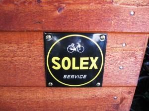Solex service, skilt ved værksted dør.